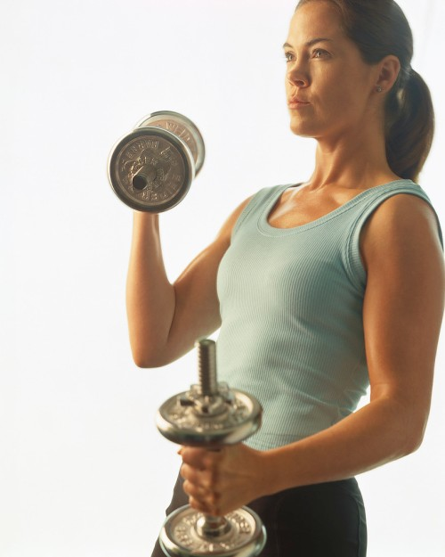 Woman Exercising with Dumbells